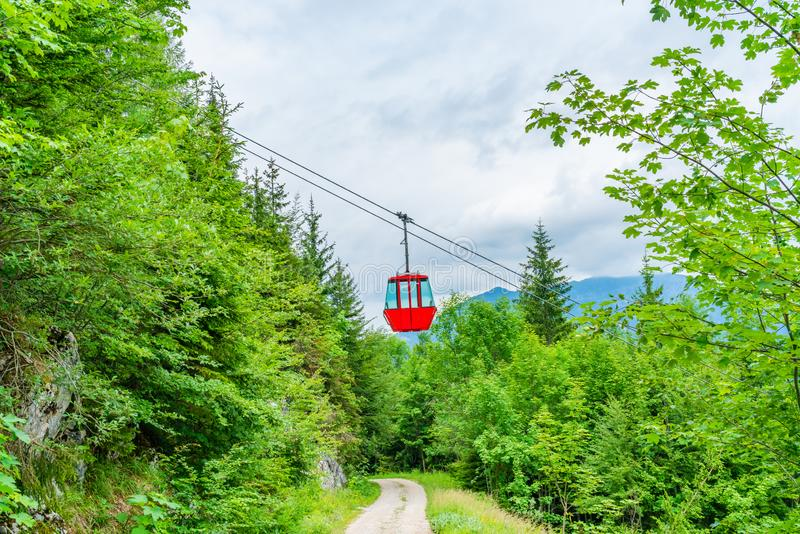 Colorful vintage gondola of Mount Katrin cable car, Austria. Colorful vintage gondola of Mount Katrin cable car and panoramic alpine view of peaks over Bad Ischl stock image