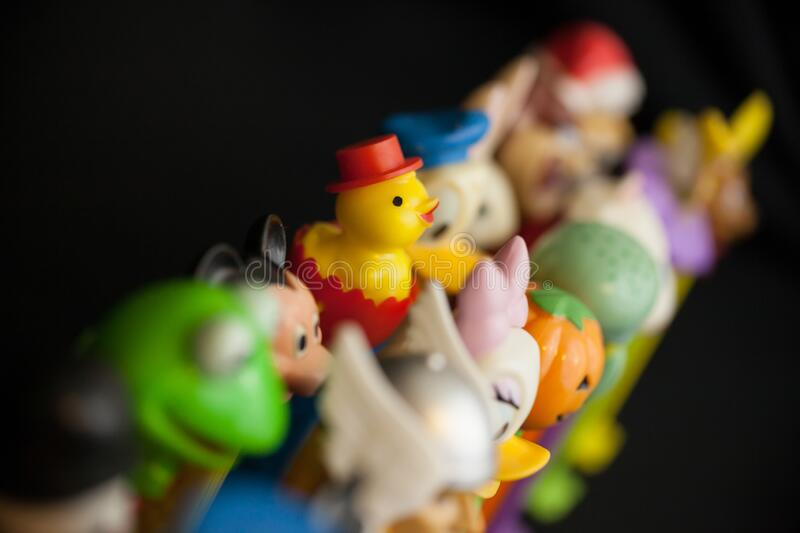 Colorful Vintage Pez Dispenser Collection with Focus on Easter Duck stock foto's
