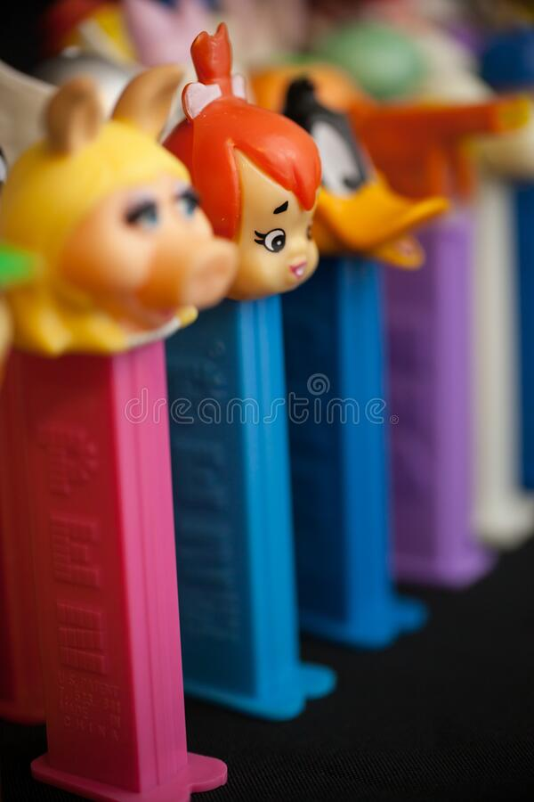 Colorful Vintage Pez Dispenser Collection with Focus on Pebbles Flintstone. WOODBRIDGE, NEW JERSEY / UNITED STATES - January 16, 2020: A variety of Pez royalty free stock photo