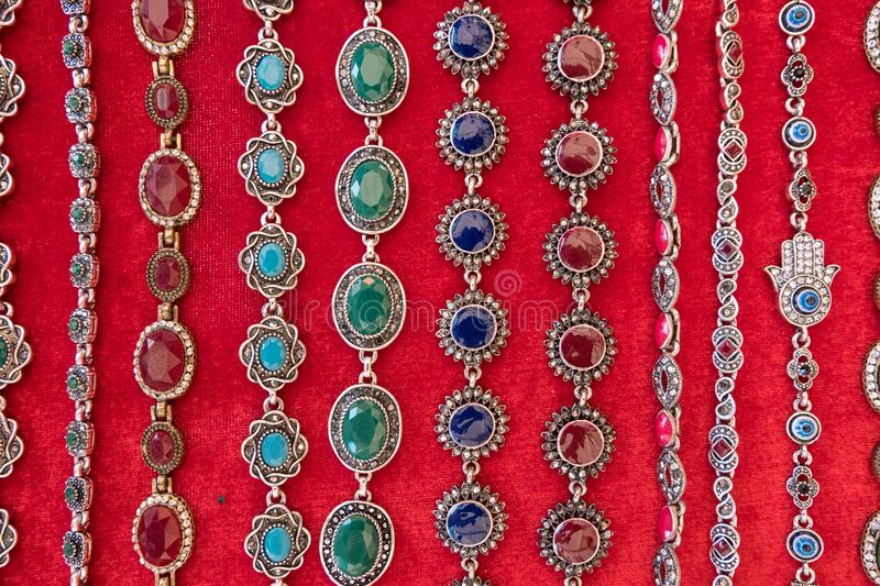 Colorful vintage stone bracelets and necklaces for sale royalty free stock photo