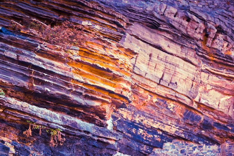 Colorful violet layers of rock stock photos