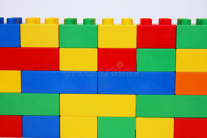 Colorful wall. Wall made of building blocks having lots of different colors royalty free stock photography