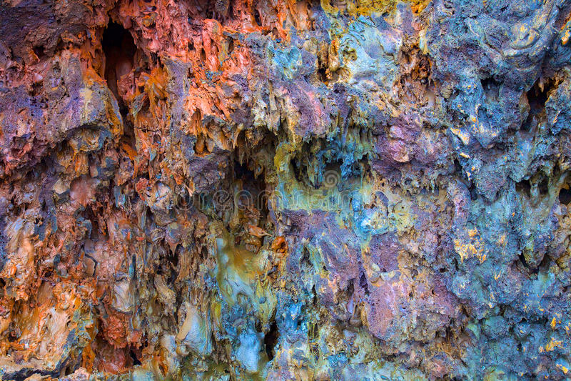 Colorful textured wall of Lava Rock stock photos
