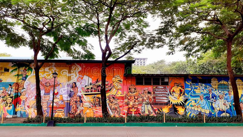 The colorful wall painting featuring filipino local tradition. Location: Luneta park, Philippines stock images