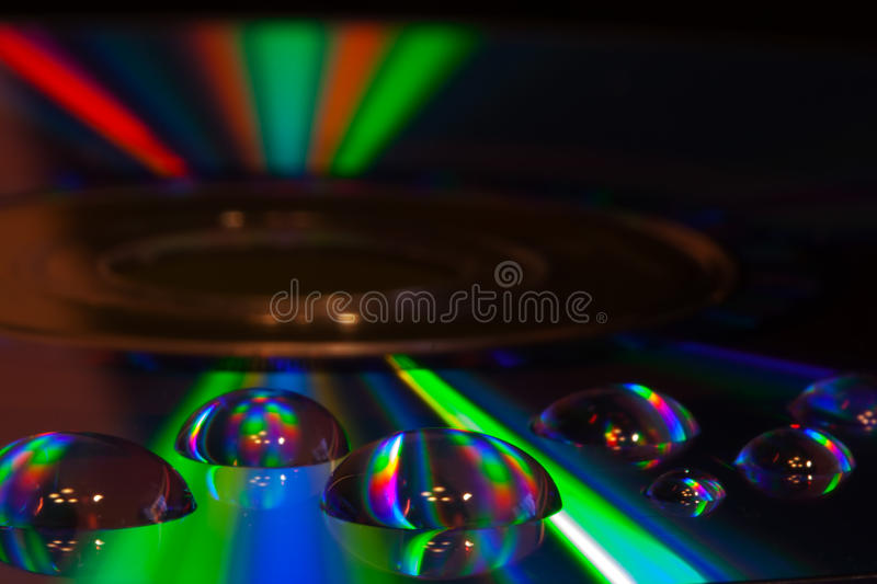 Colorful water drops on CD/DVD disc royalty free stock images