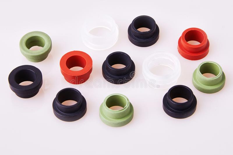 Colorful water level rubber gaskets scattered on the table. Top viev. Rubber sealing gaskets royalty free stock photography