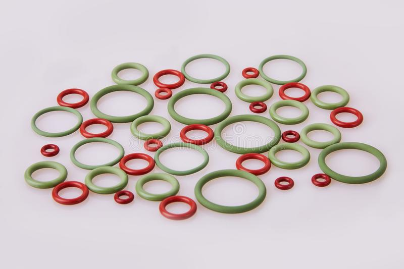 Colorful water level rubber gaskets scattered on the table. Top viev. Rubber sealing gaskets royalty free stock images