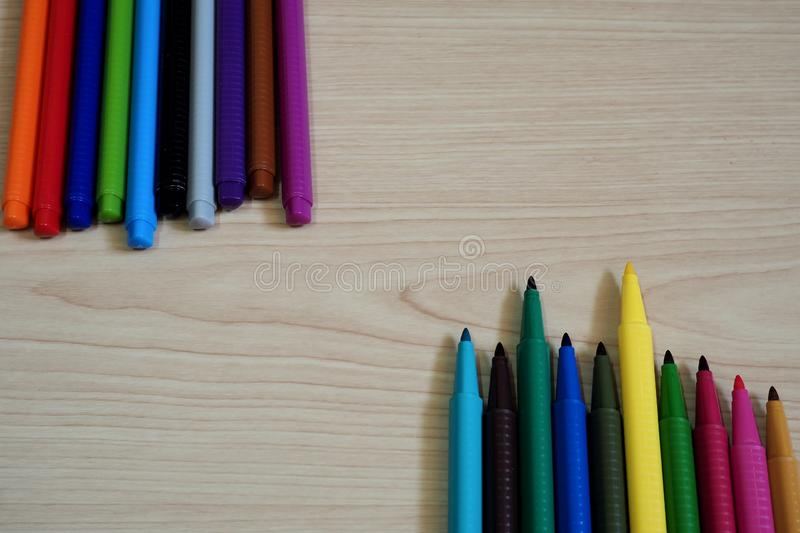 Marker Pens on wooden table background. Colorful water Marker Pens put on wooden table background with space for using stock photo
