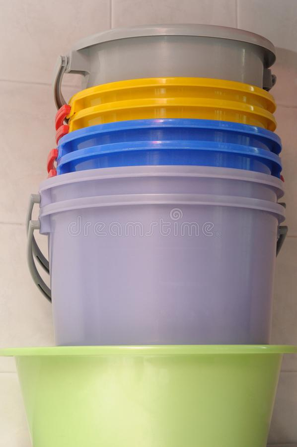 Colorful water pails stock photo