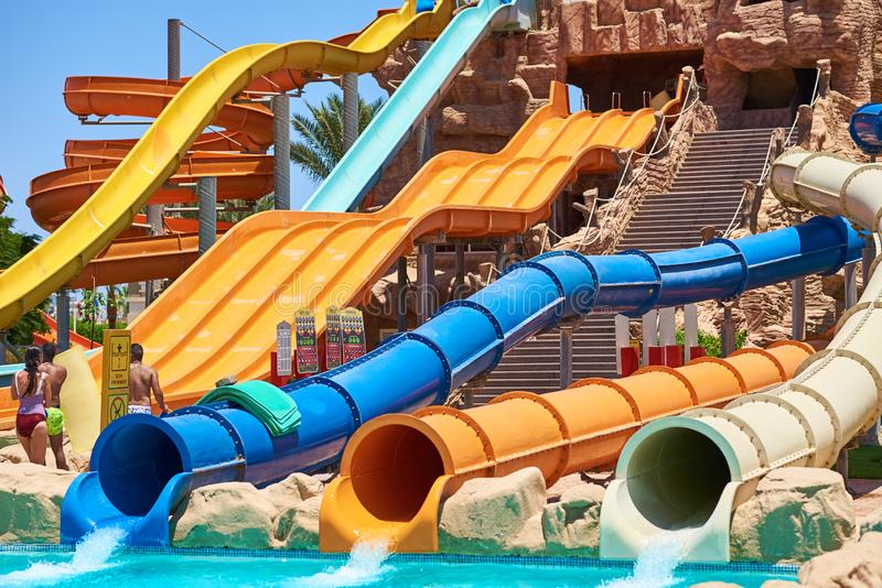 Colorful water slides in aqua park, closeup royalty free stock images