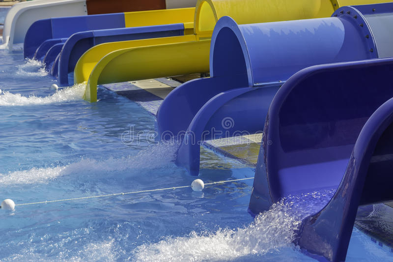 Colorful water slides at the aqua park stock image