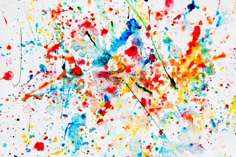 Colorful watercolor splash on white paper. Art background stock photography