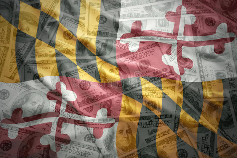 Colorful waving maryland state flag on a american dollar money background stock photos