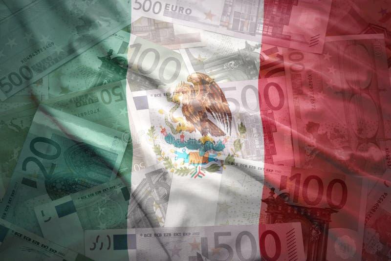 Colorful waving mexican flag on a euro background. Colorful waving mexican flag on a euro money background stock photos
