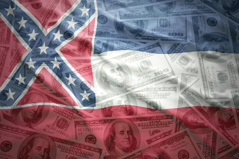 Colorful waving mississippi state flag on a american dollar money background royalty free stock photos