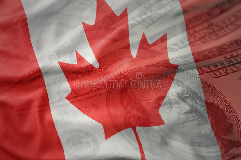 Colorful waving national flag of canada on a american dollar money background. stock photos