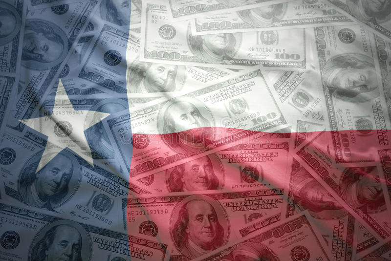 Colorful waving texas state flag on a american dollar money background stock images