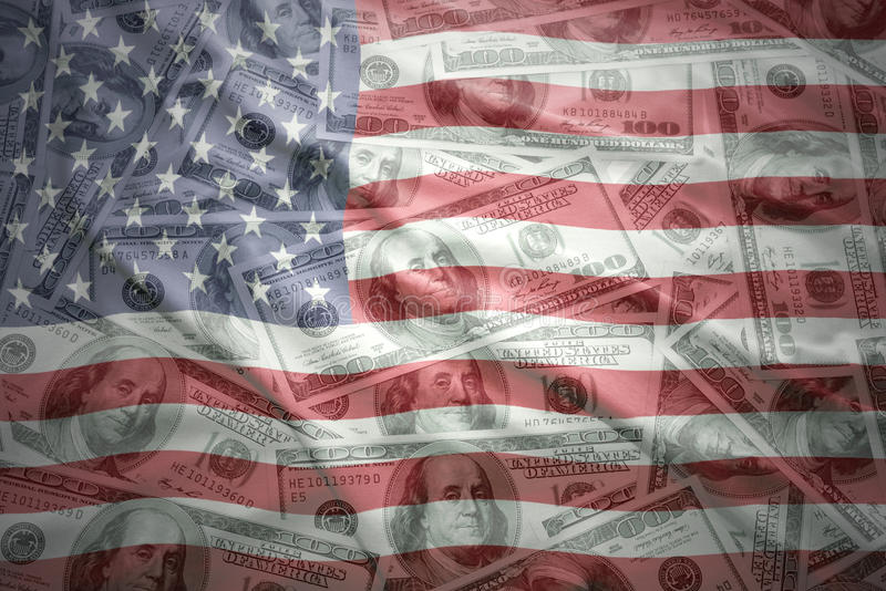 Colorful waving united states of america flag on a american dollar money background royalty free stock images