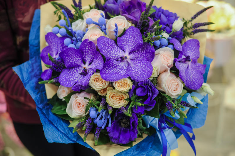 Colorful wedding bouquet with beautiful purple orchid stock photos