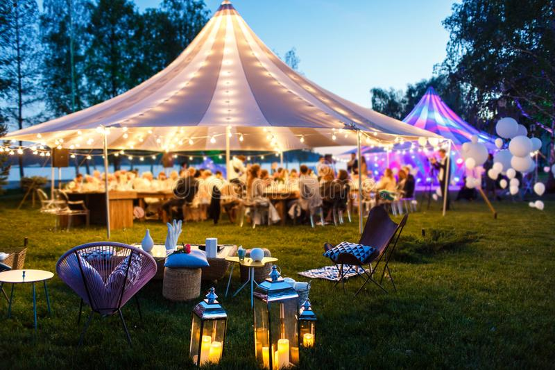 Colorful wedding tents at night. Wedding day royalty free stock photos
