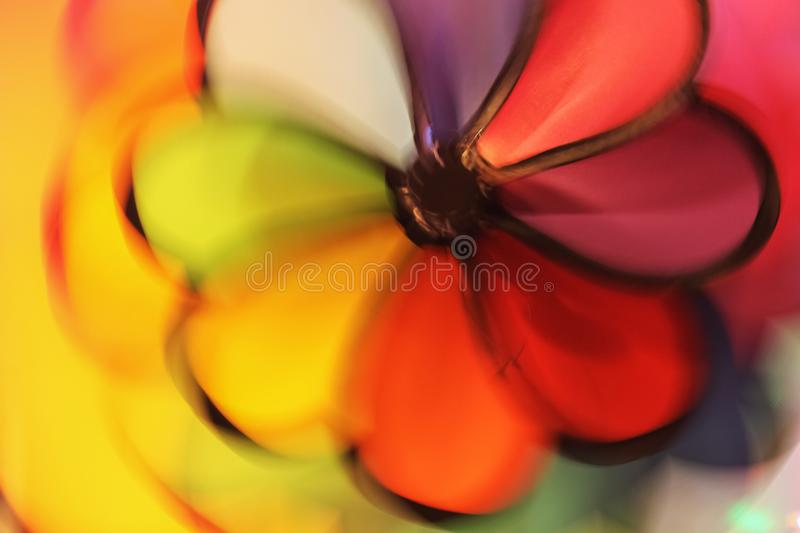 Colorful whirl-a-jig background with blurred motion in yellow red purple and green.  royalty free stock image