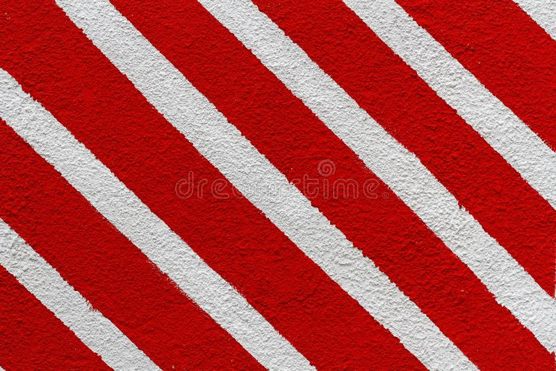 Colorful white and red painted striped wall stock image