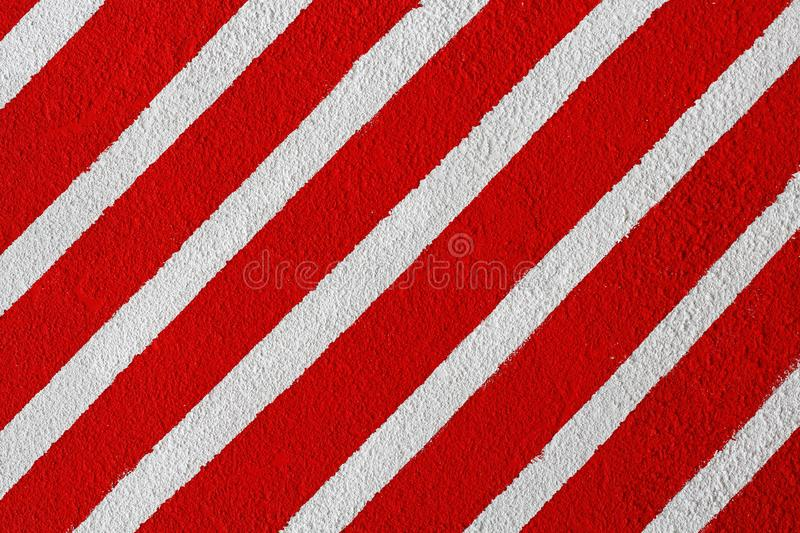 Colorful white and red painted striped wall royalty free stock images