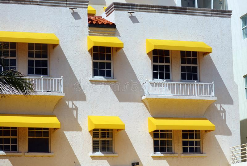 Art deco Colorful white and yellow windows in the streets of Miami beach south Florida houses Ocean drive. Colorful white and yellow windows in the streets of royalty free stock image