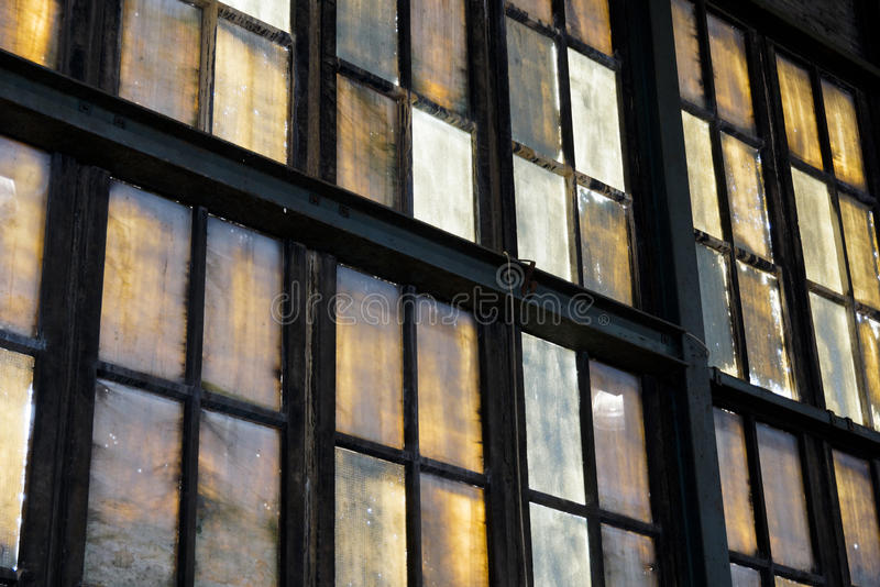 Colorful windows in abandoned factory. Colorful windows of an abandoned factory royalty free stock photos