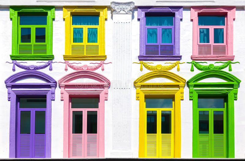 Colorful windows and white building facade.  stock photo
