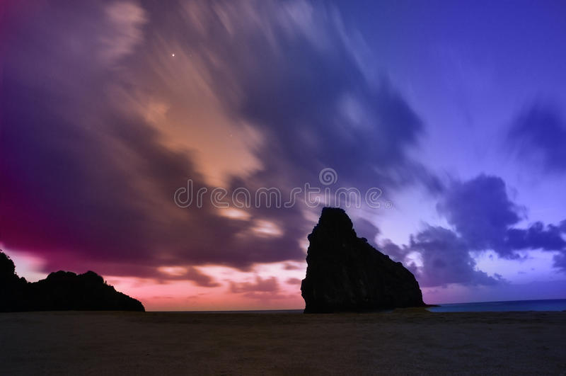 Colorful windy sunset. Moving clouds at dusk royalty free stock image