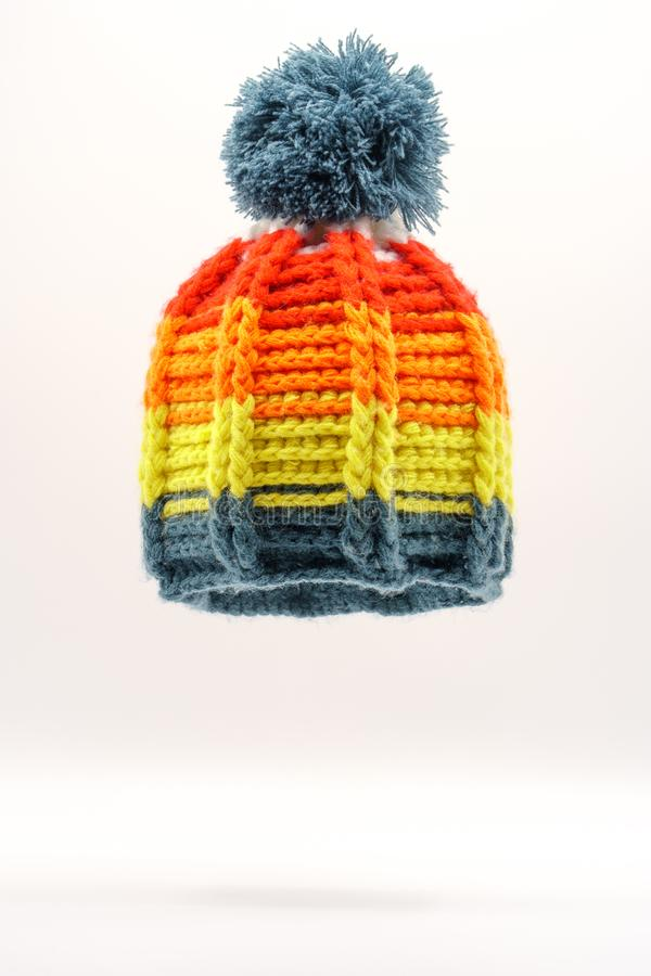 Colorful winter knitted hat on a white background. Handwork. Winter fashion concept for men, women and children stock photography