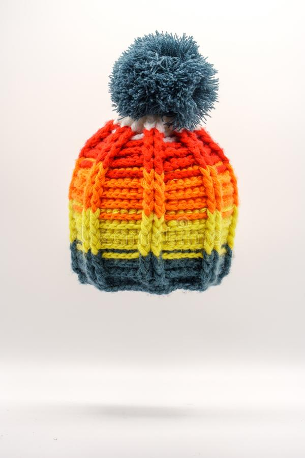 Colorful winter knitted hat on a white background. Handwork. Winter fashion concept for men, women and children royalty free stock image