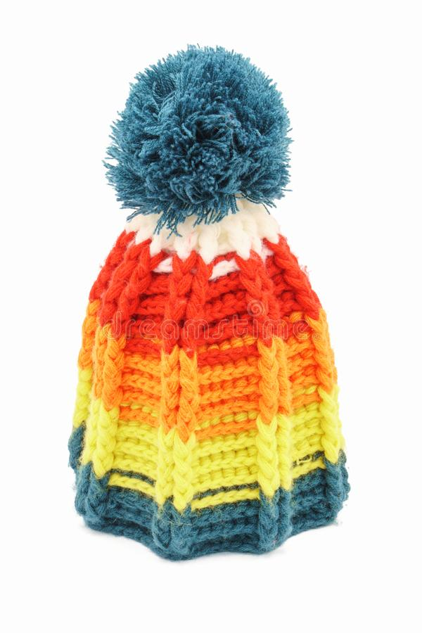 Colorful winter knitted hat on a white background. Handwork. Winter fashion concept for men, women and children royalty free stock photography