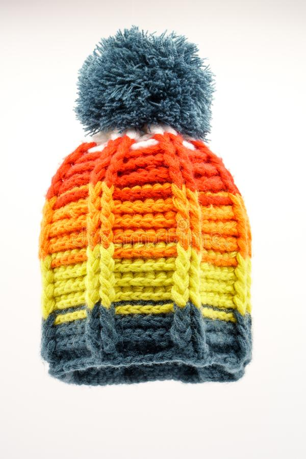 Colorful winter knitted hat on a white background. Handwork. Winter fashion concept for men, women and children stock photos