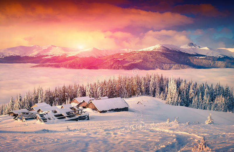 Colorful winter sunrise in foggy mountains royalty free stock photo