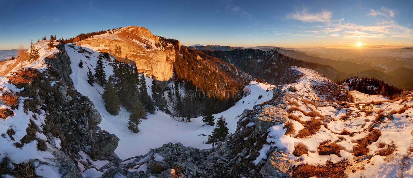 Colorful winter sunrise in the mountains stock image