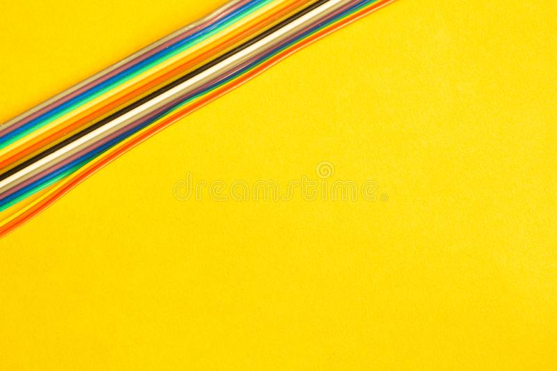 Colorful wires isolated on yellow background. connection wire for electrical schemes. copy space royalty free stock image