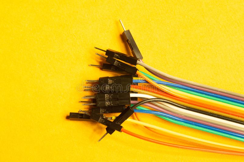 Colorful wires isolated on yellow background. connection wire for electrical schemes. copy space. Colorful wires isolated on yellow background. connection wire stock image