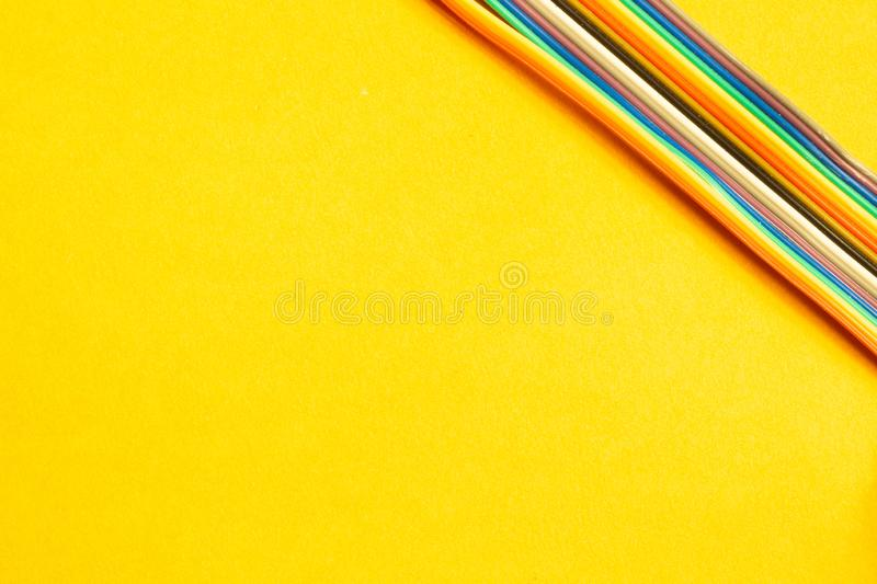 Colorful wires isolated on yellow background. connection wire for electrical schemes. copy space. Colorful wires isolated on yellow background. connection wire stock photos