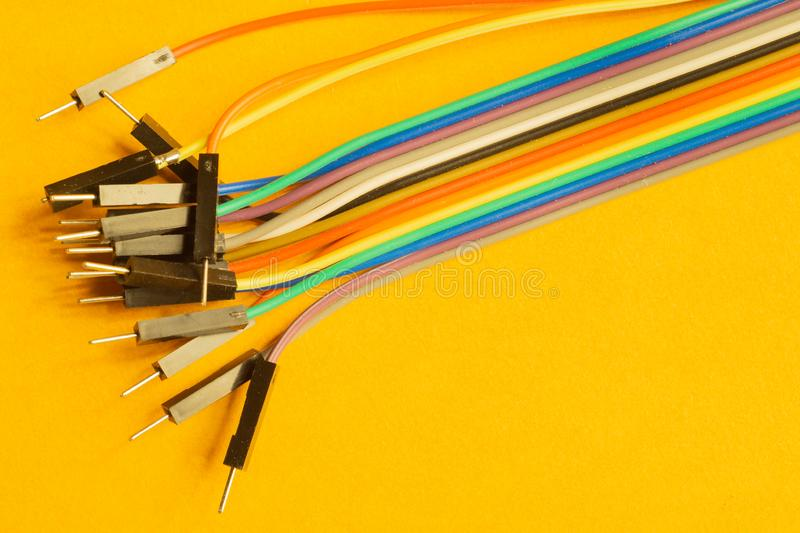 Colorful wires isolated on yellow background. connection wire for electrical schemes. copy space. Colorful wires isolated on yellow background. connection wire stock images