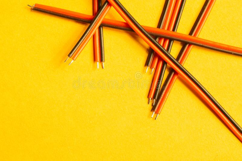 Colorful wires isolated on yellow background. connection wire for electrical schemes. copy space. Colorful wires isolated on yellow background. connection wire royalty free stock photo