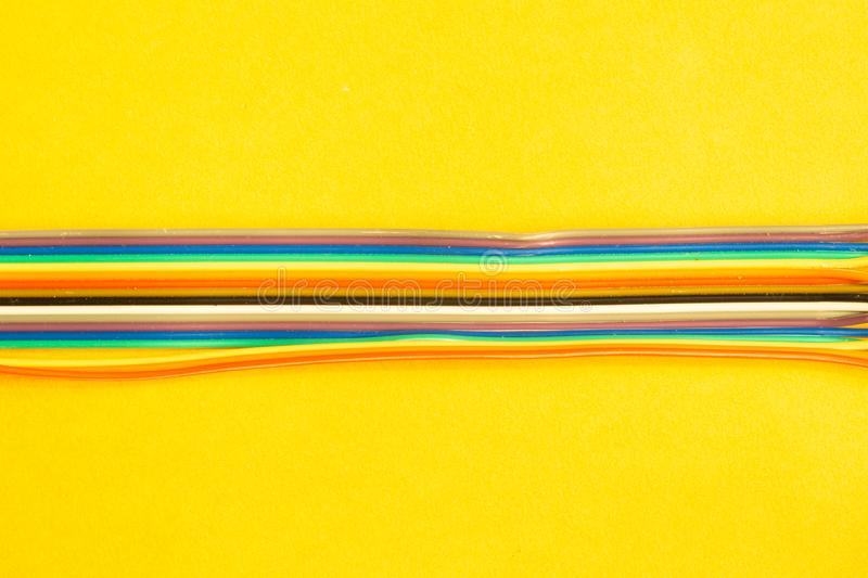 Colorful wires isolated on yellow background. connection wire for electrical schemes. copy space. Colorful wires isolated on yellow background. connection wire royalty free stock image