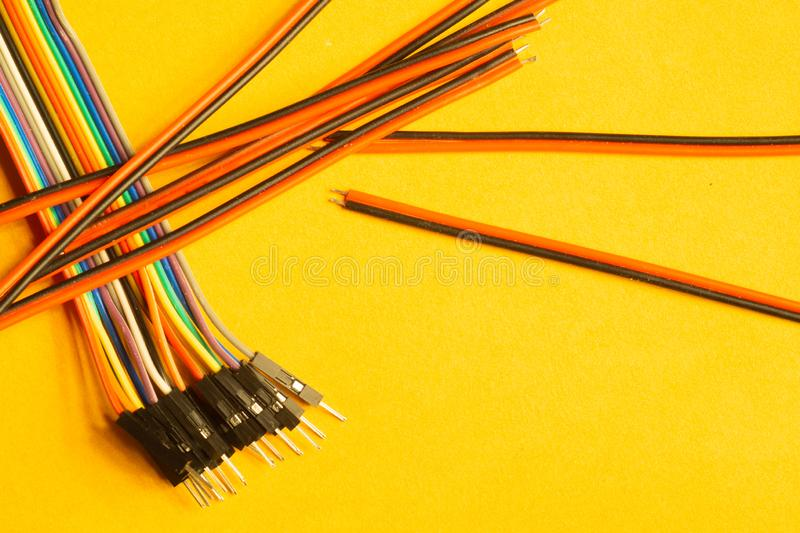 Colorful wires isolated on yellow background. connection wire for electrical schemes. copy space. Colorful wires isolated on yellow background. connection wire royalty free stock photography