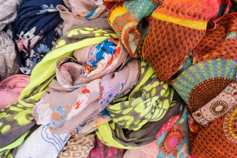 Colorful woman clothes close-up at a market display stock photos