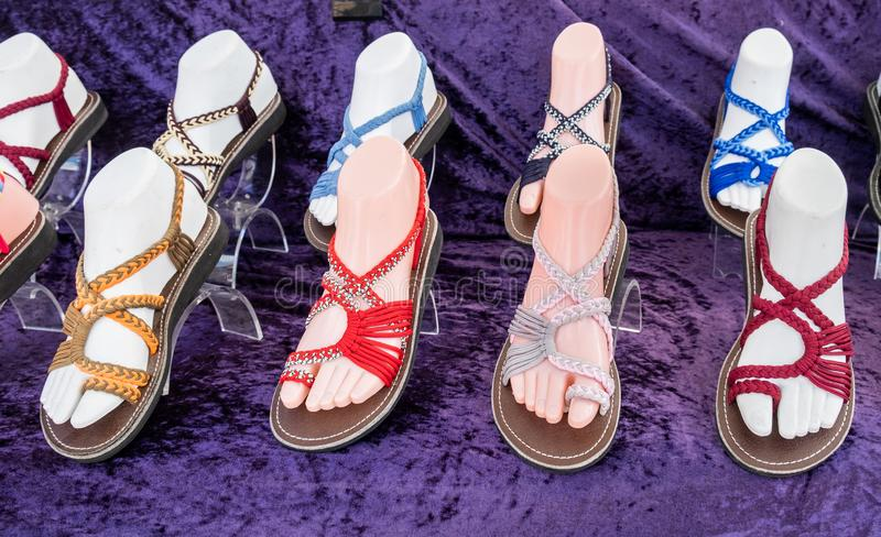 Colorful women sandals for sale at shoe store royalty free stock images