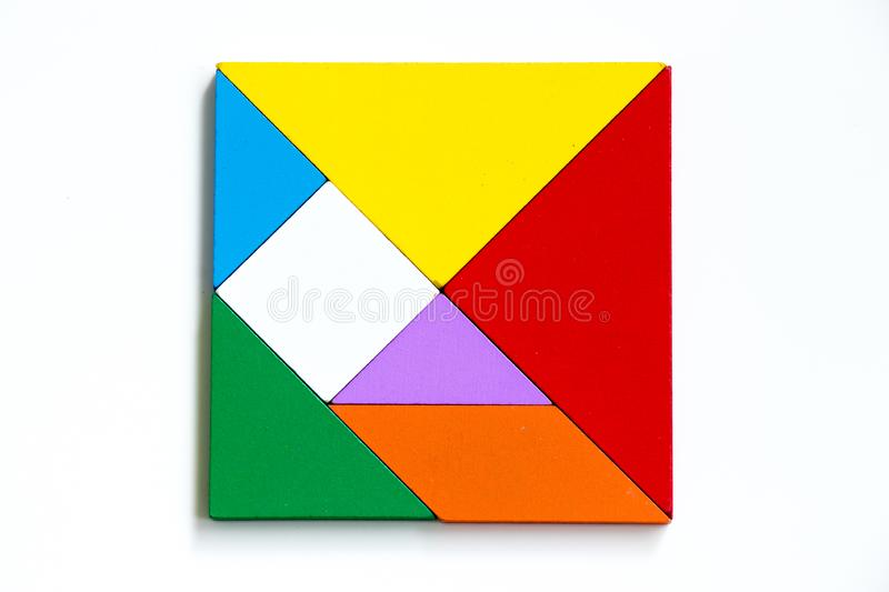 Colorful wood tangram puzzle in square shape on white background royalty free stock photography