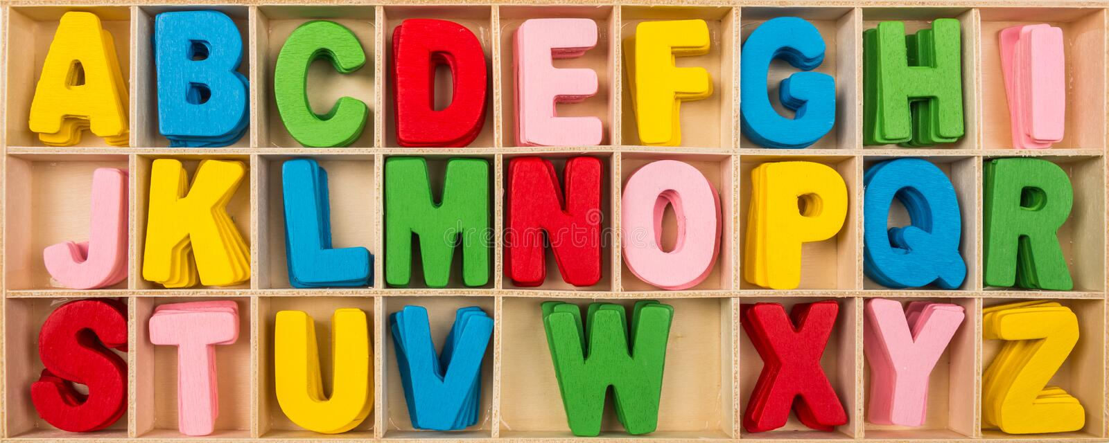 Colorful wooden alphabet letters stock photo