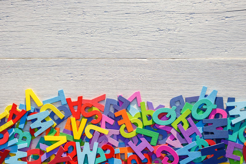 Colorful wooden alphabet. Top view on white wooden. Background royalty free stock photos