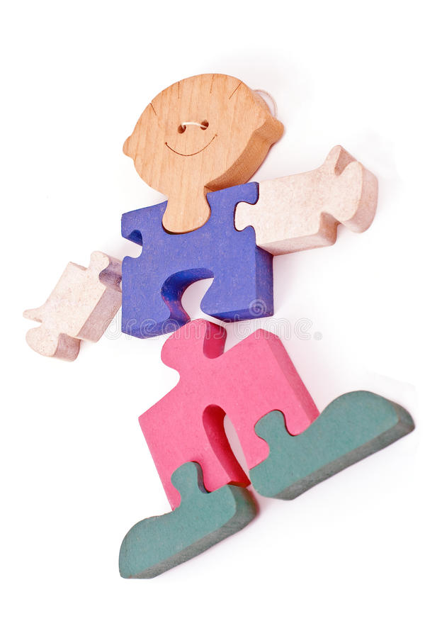 Colorful wooden boy puzzle pieces. On white stock photo
